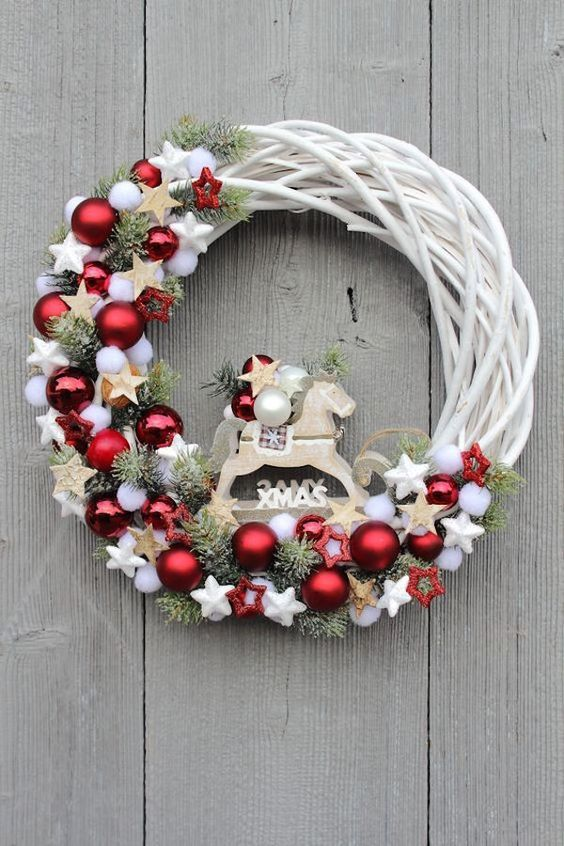 White Christmas wreath with red baubles
