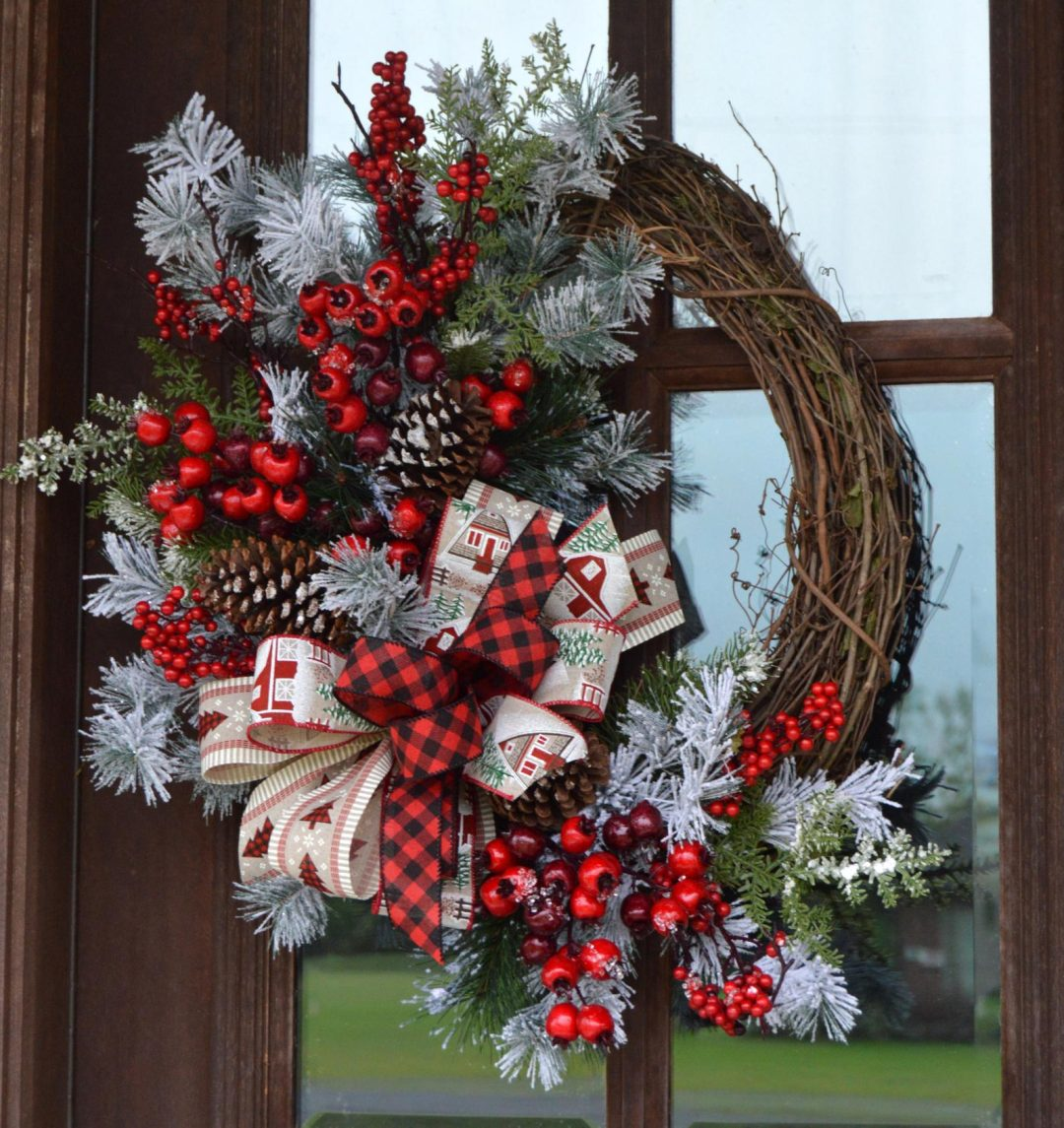 Red berries and ribbons farmhouse Christmas wreath with grapevine