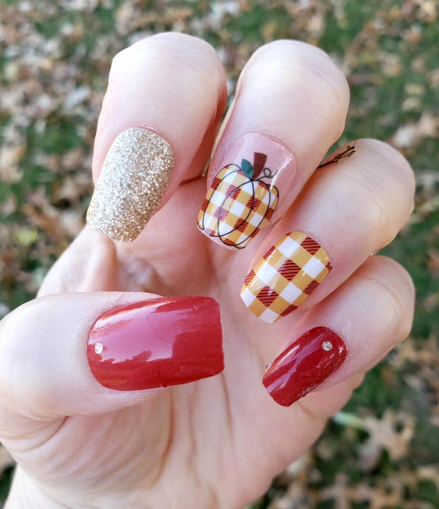 Fall pumpkin patch nails with plaid pattern