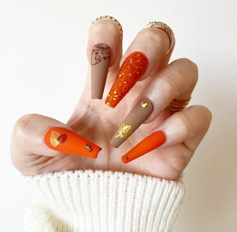 Matte brown and burnt orange fall nails in coffin shape