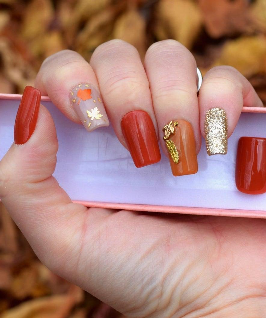 Burnt orange and brown fall nails with glitter