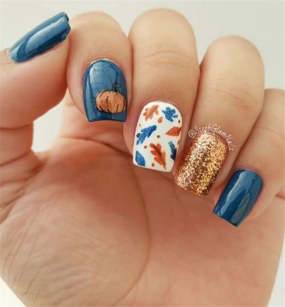 Navy blue nail idea with leaf decals