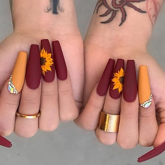 Matte maroon red coffin fall nails with matte orange sunflowers