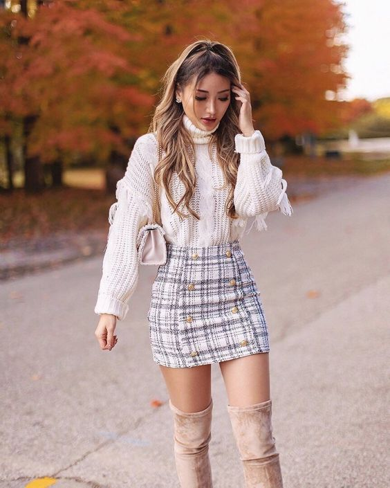 Cute Thanksgiving outfits with plaid skirt, white sweater and over the knee boots