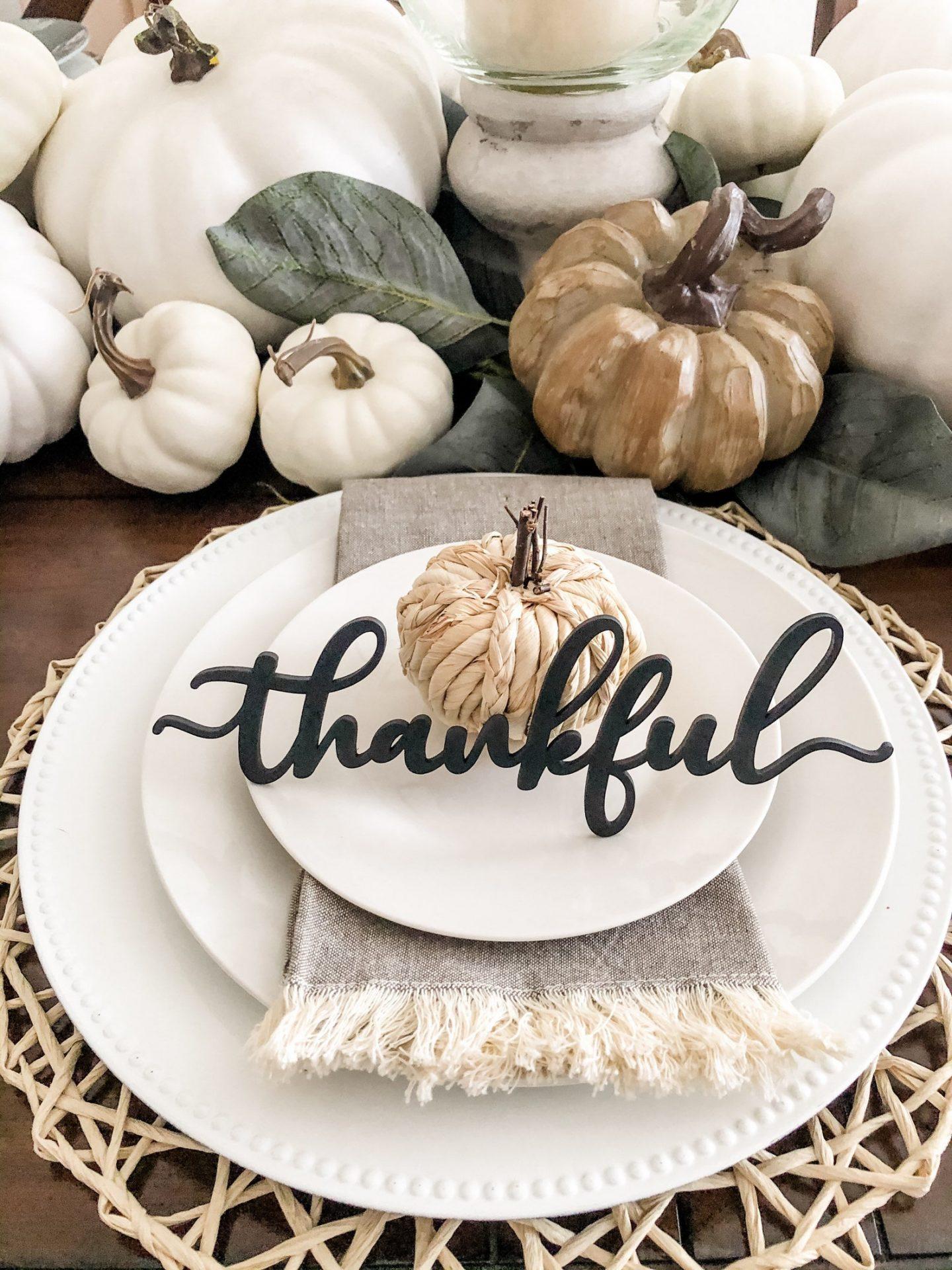 Elegant Thanksgiving table settings with white pumpkins