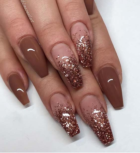 Brown acrylic coffin nails and gold glitter
