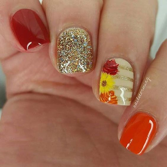 Cute Thanksgiving nails with orange and gold glitter