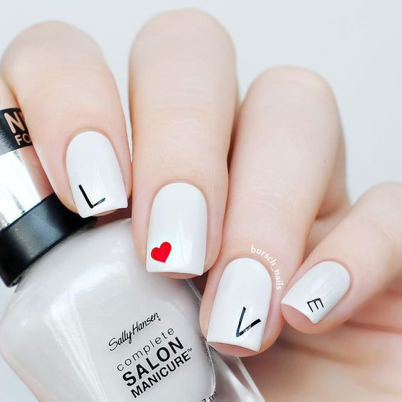Simple white Valentine's day nails that spell out love
