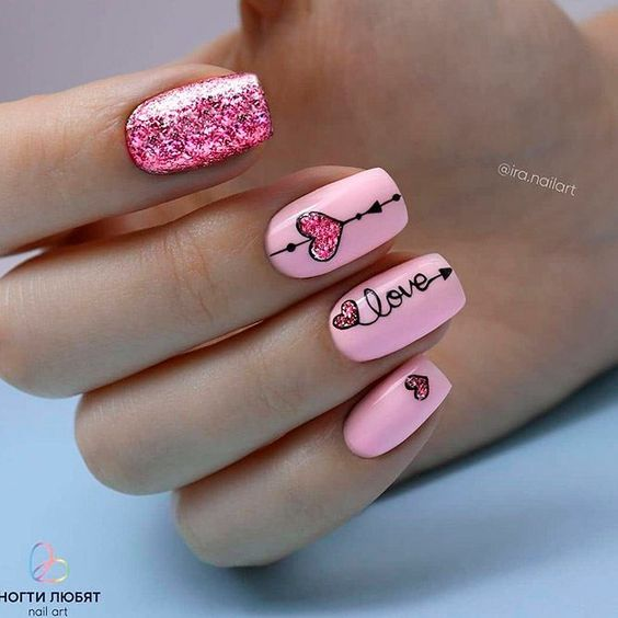 Cute pink Valentine's day nails with heart nail art
