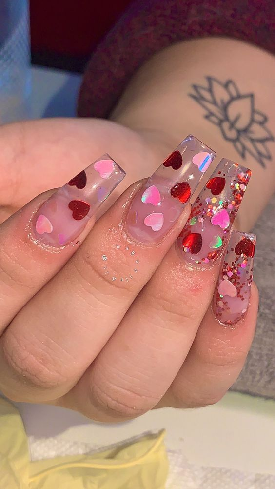 Cute transparent Valentine's day nails with heart nail art