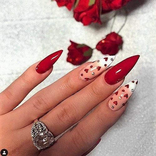 Cute red acrylic Valentine's day nails with heart nail art