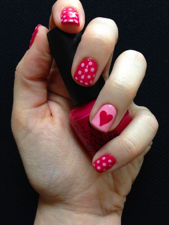 Short pink and red Valentine nails with heart and polka dots