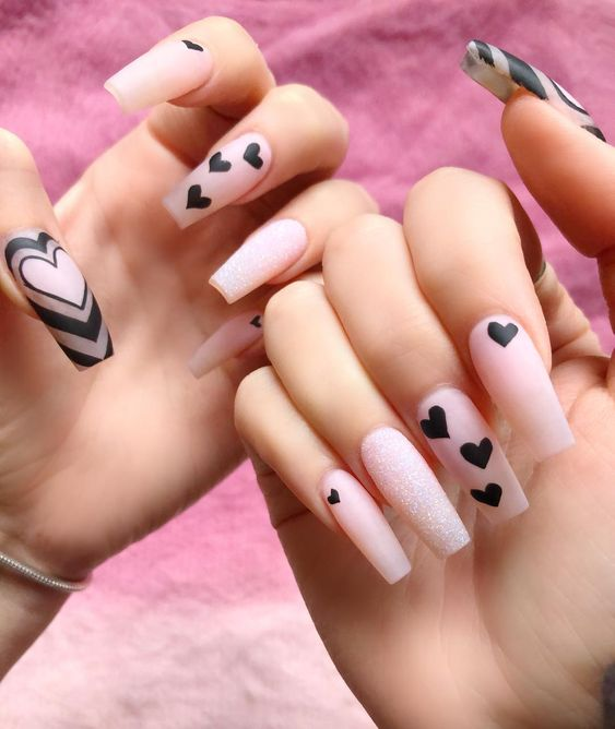 Cute light pink Valentine's day nails with heart nail art