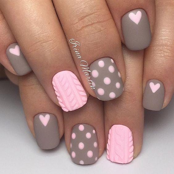 Short, grey and pink Valentine nails with heart nail art