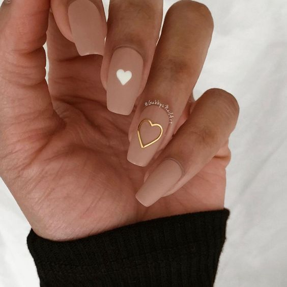 Simple Valentine's day nails with heart nail art in neutral colors
