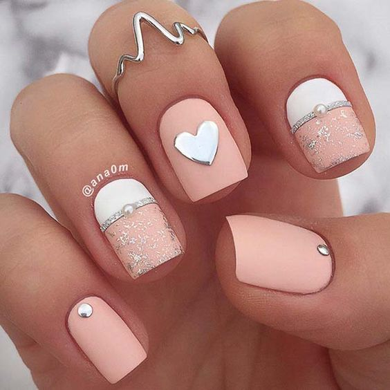 Cute white and pink Valentine's day nails with heart nail art