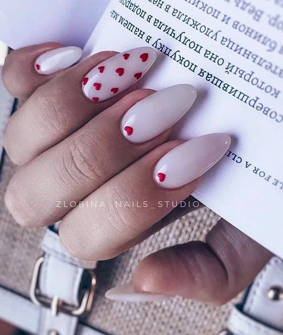 Simple Valentine's day nails with heart nail art in almond shape
