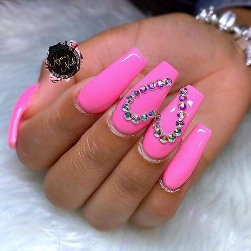 Acrylic hot pink Valentine's nails with heart nail art
