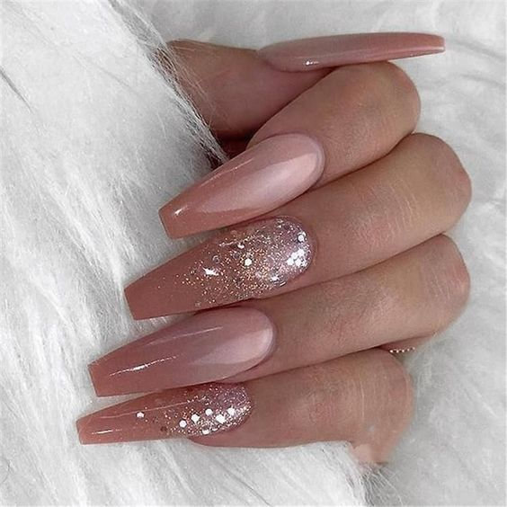 Pink ombre nails with glitter