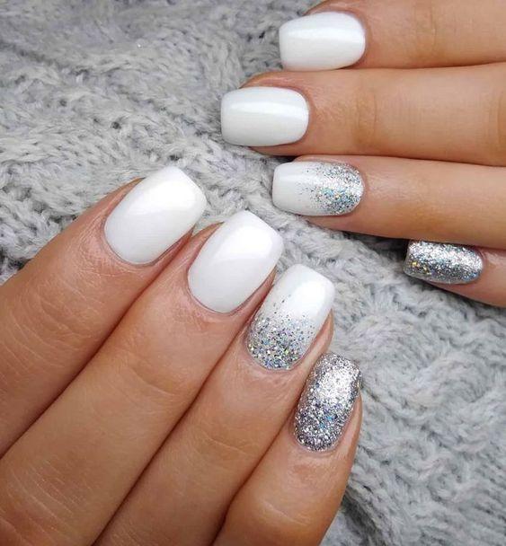 Short white nails with glitter