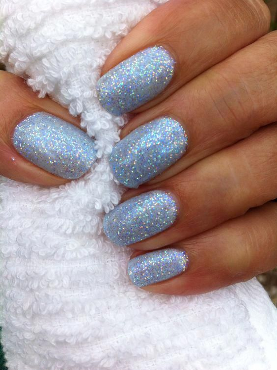 Light blue winter nails with glitter