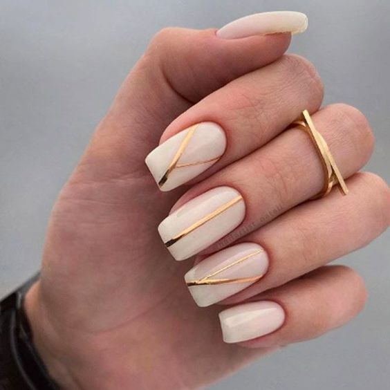 Neutral nails with gold stripes
