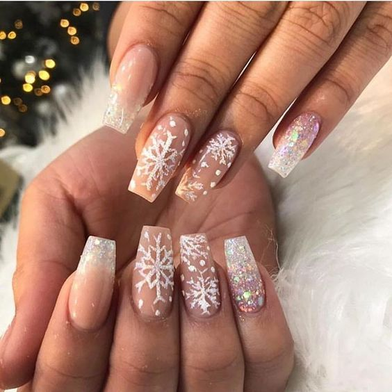 Cute snowflake nails on acrylic coffin nails