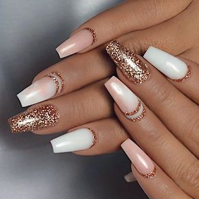 Pink and white winter nails with glitter