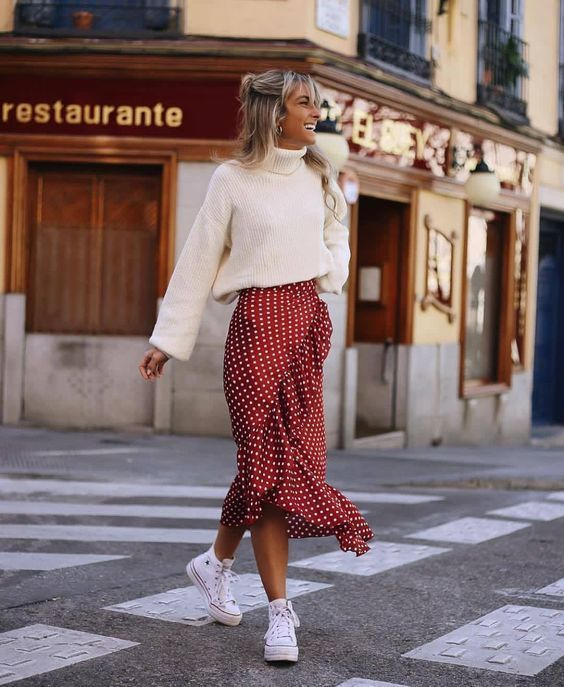 Casual and cute Christmas outfits with polka dot skirt and white sweater