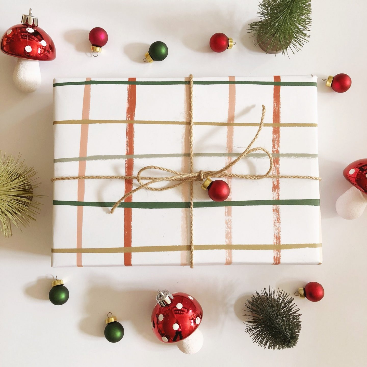 Minimalist plaid wrapping paper with small Christmas bells