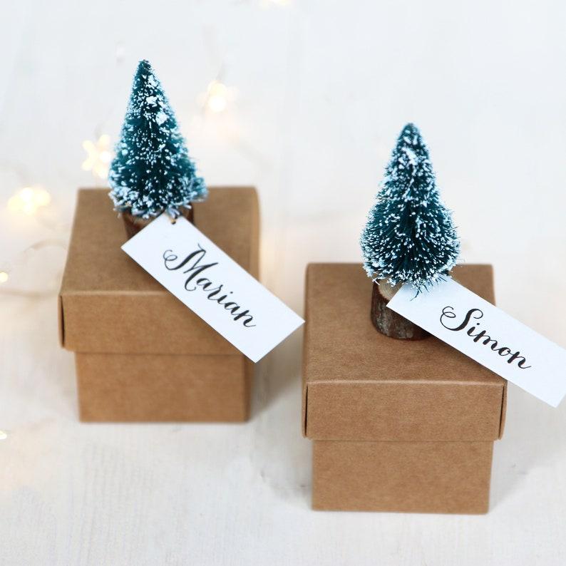 Christmas gift wrapping with small Christmas trees