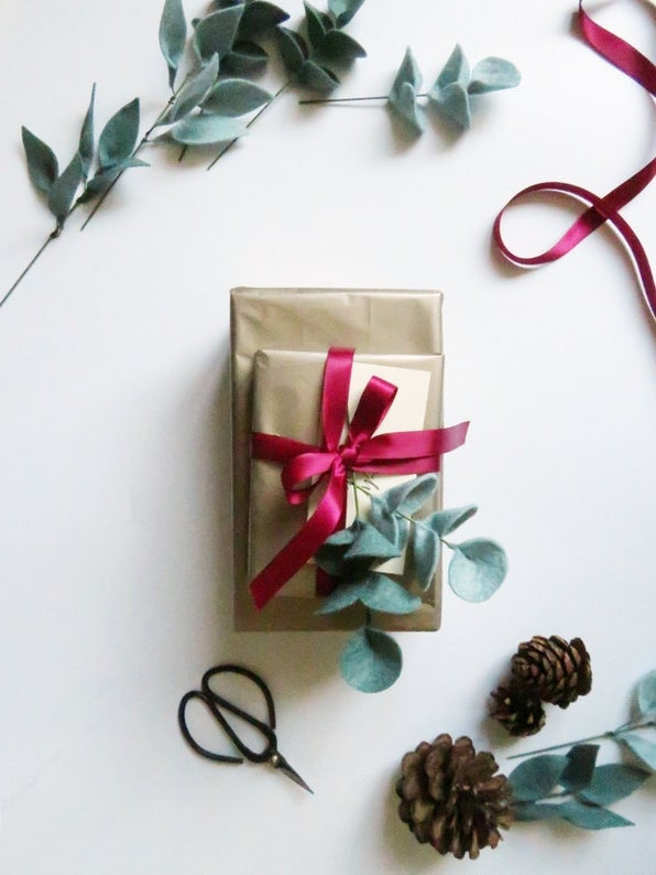 Cute Christmas gift wrapping with eucalyptus stems