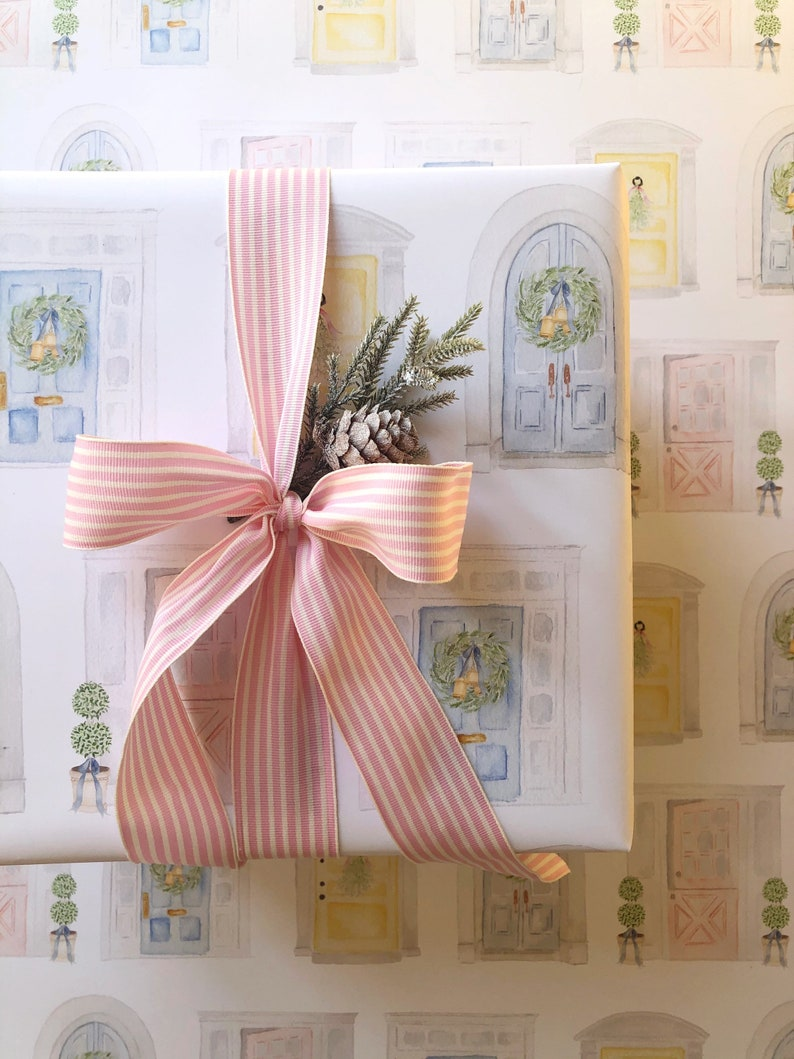 Elegant pastel Christmas gift wrapping paper with pink bow