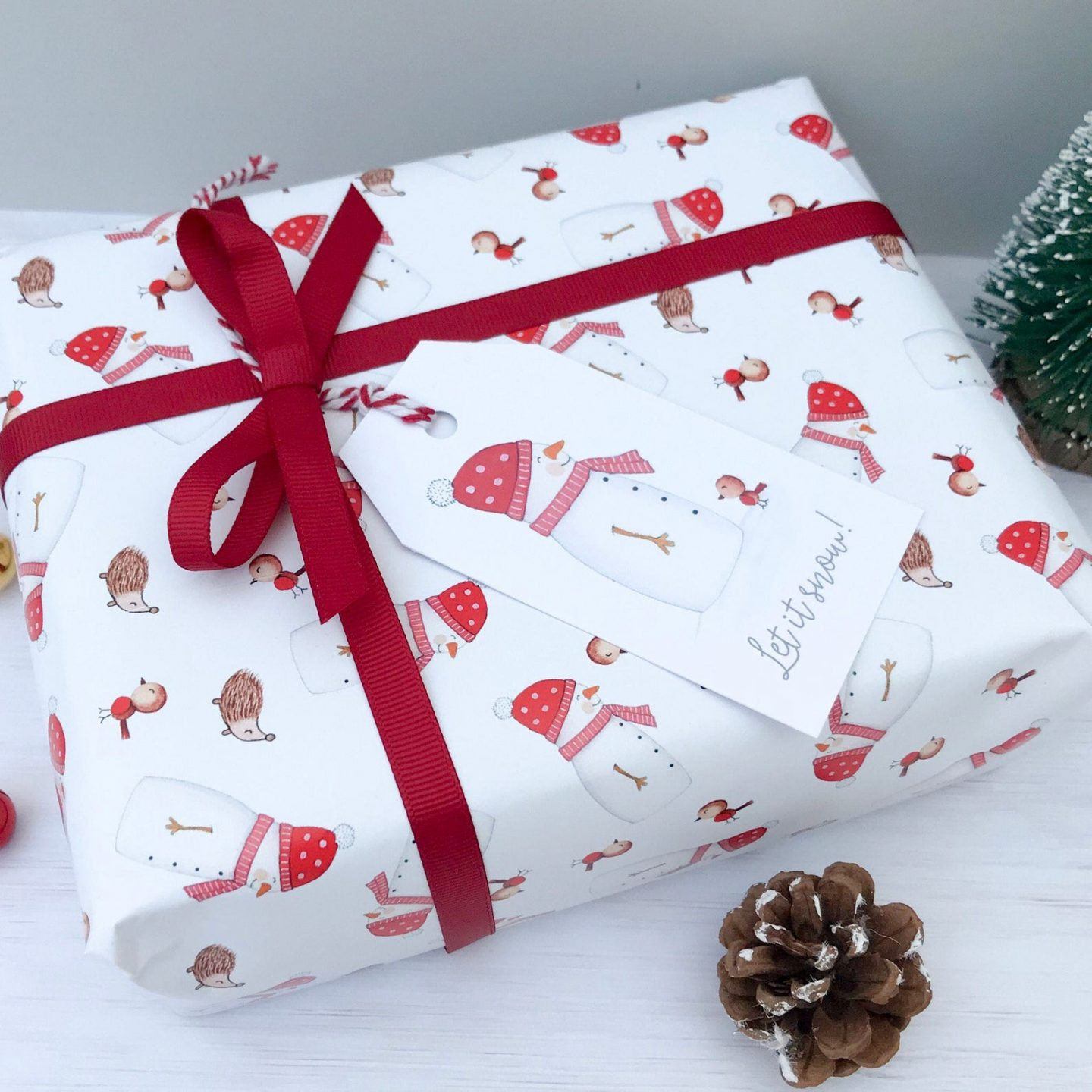 Cute white and red Christmas gift wrapping paper with snowman