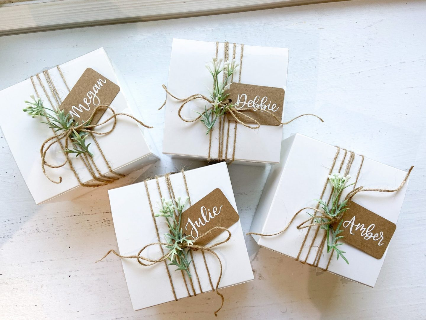 White Christmas gift wrapping idea with brown tags