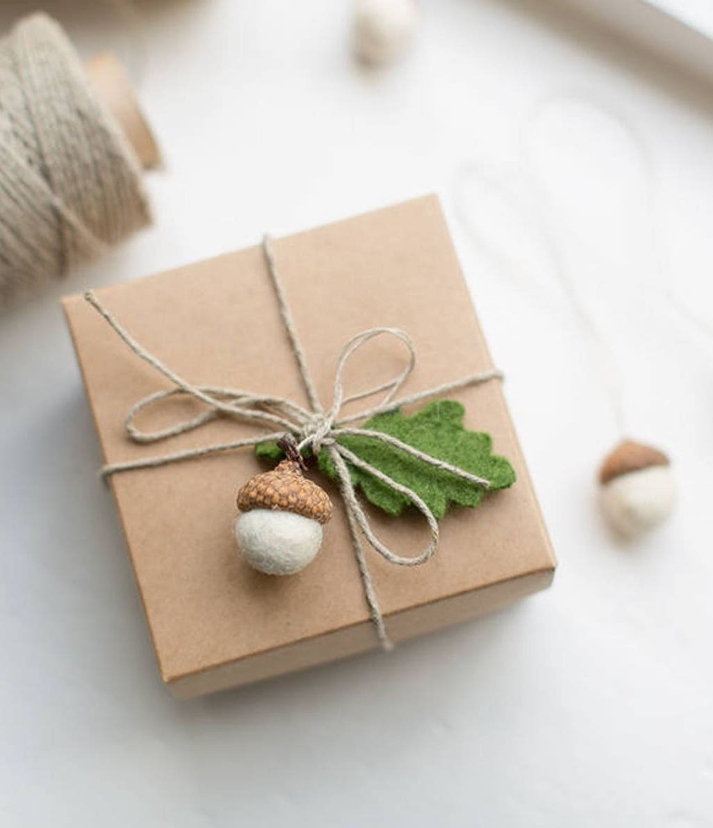 Brown Christmas gift wrapping idea with felted acorns