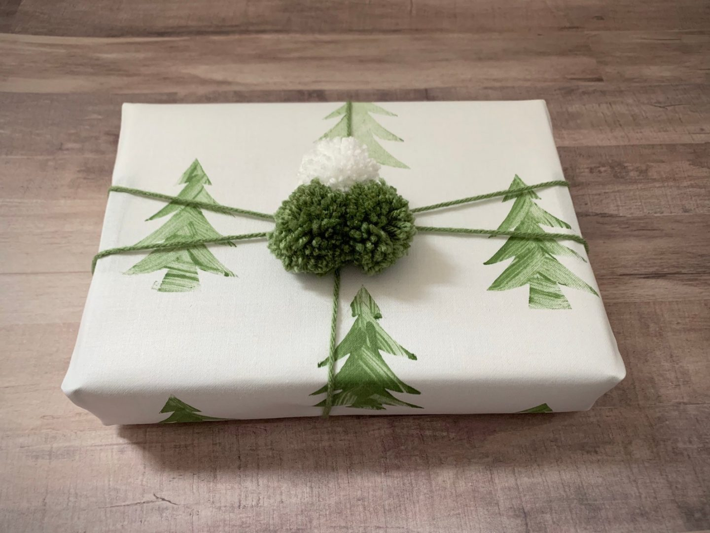 Christmas wrapping paper with Christmas trees and Green Pom Poms