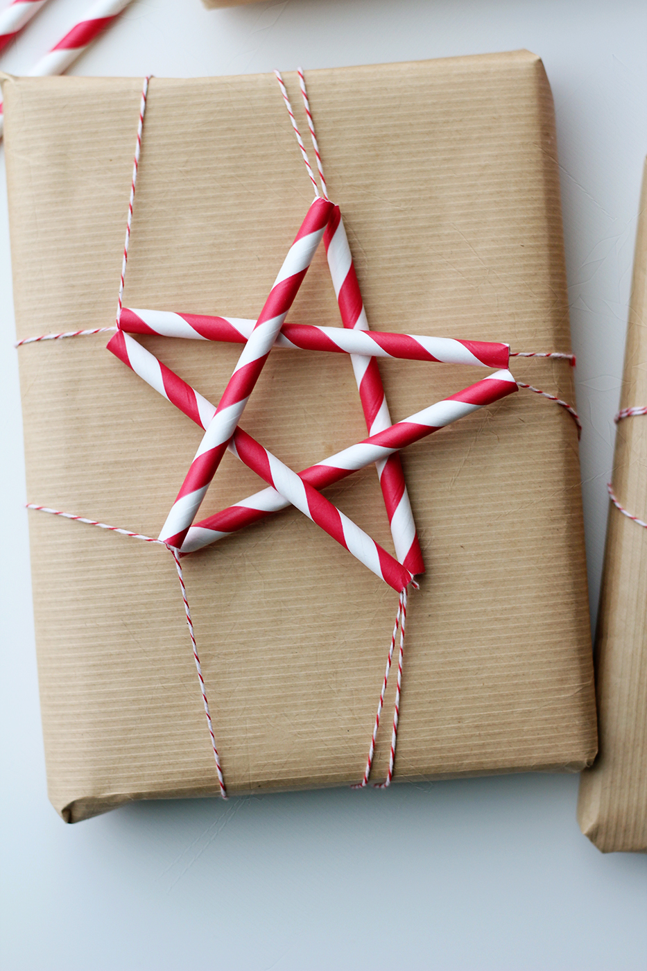 DIY brown paper straw star gift toppers for Christmas