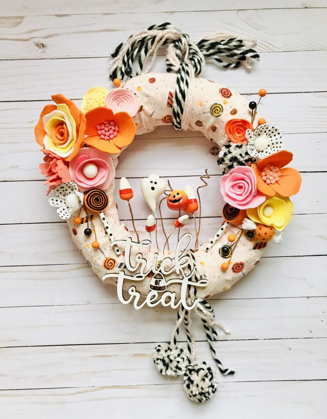 Cute Halloween wreaths with trick or treat sign