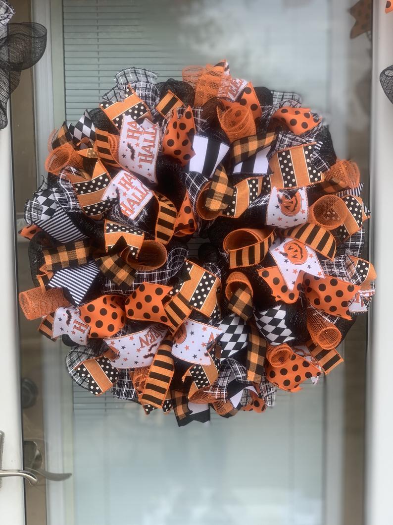 Black and orange Halloween wreaths for front doors