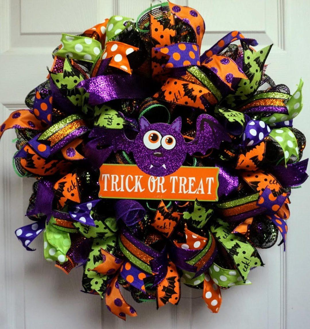 Orange, green and purple Halloween wreaths with bat