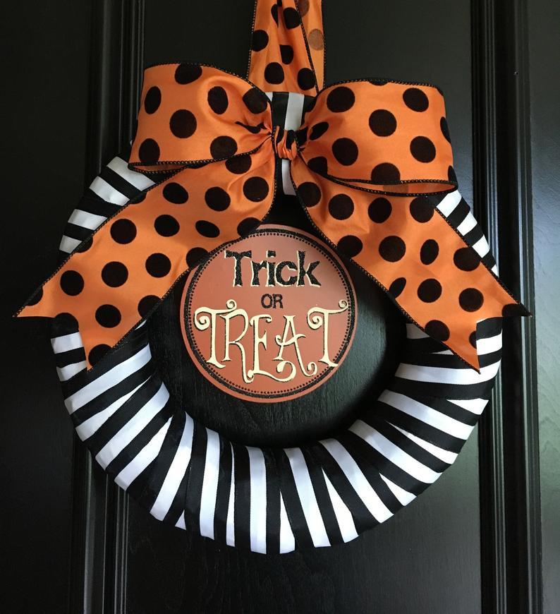 Cute orange, black and white trick or treat wreath