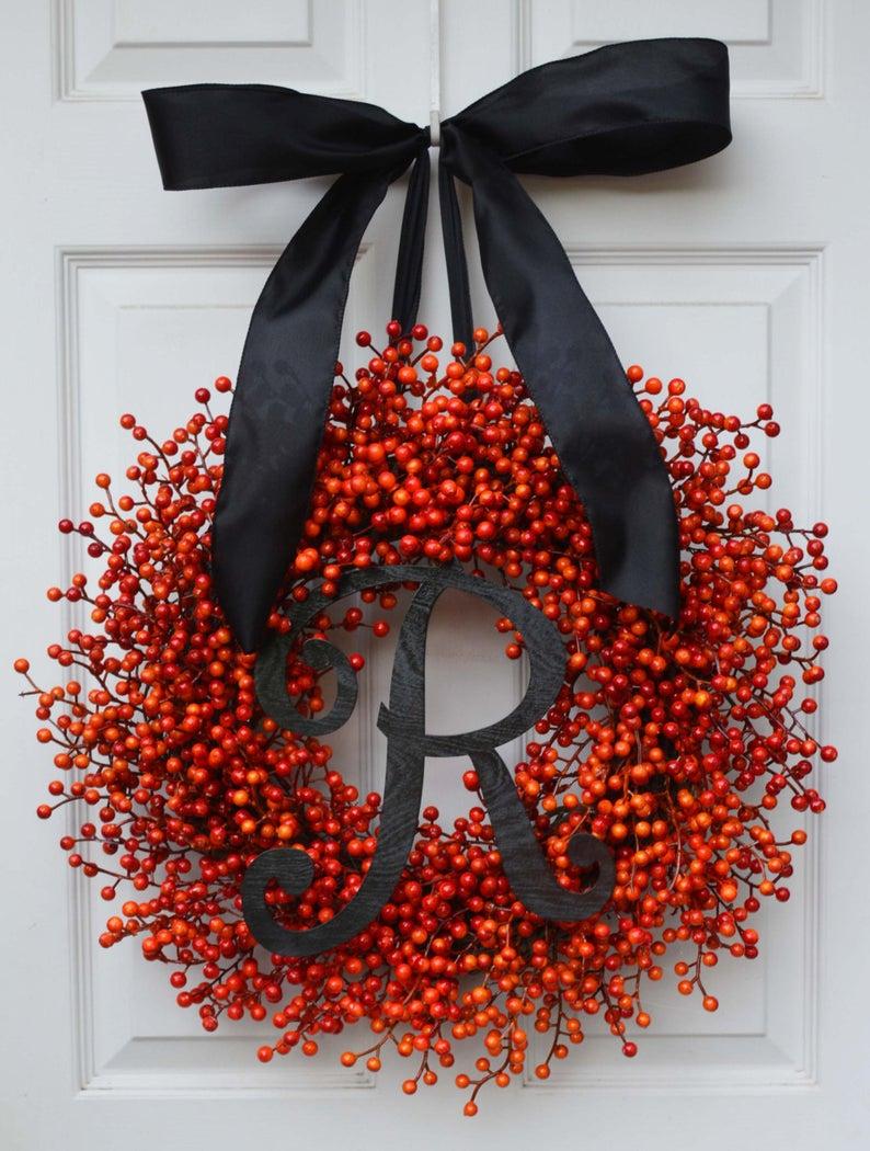 Elegant Halloween wreaths with monogram and ribbon