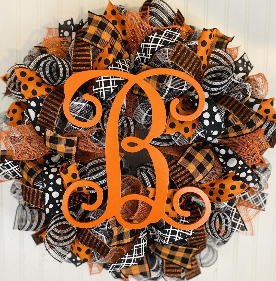 White, black and orange deco mesh Halloween wreath with monogram