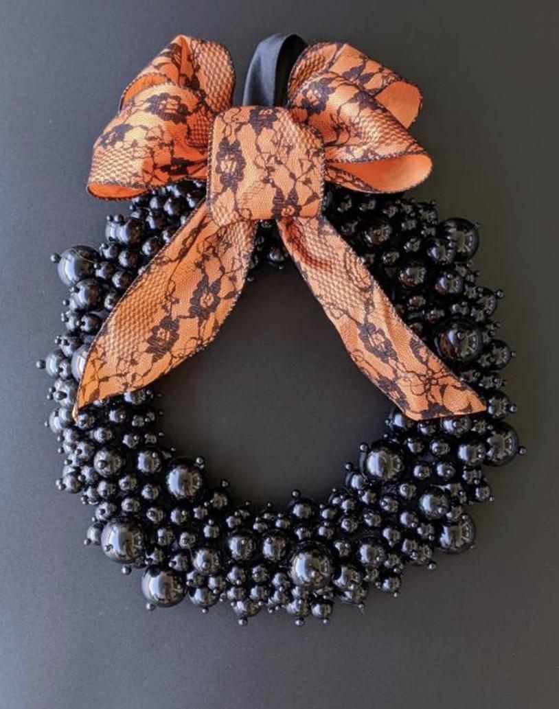 Modern and elegant black Halloween wreaths with ribbon