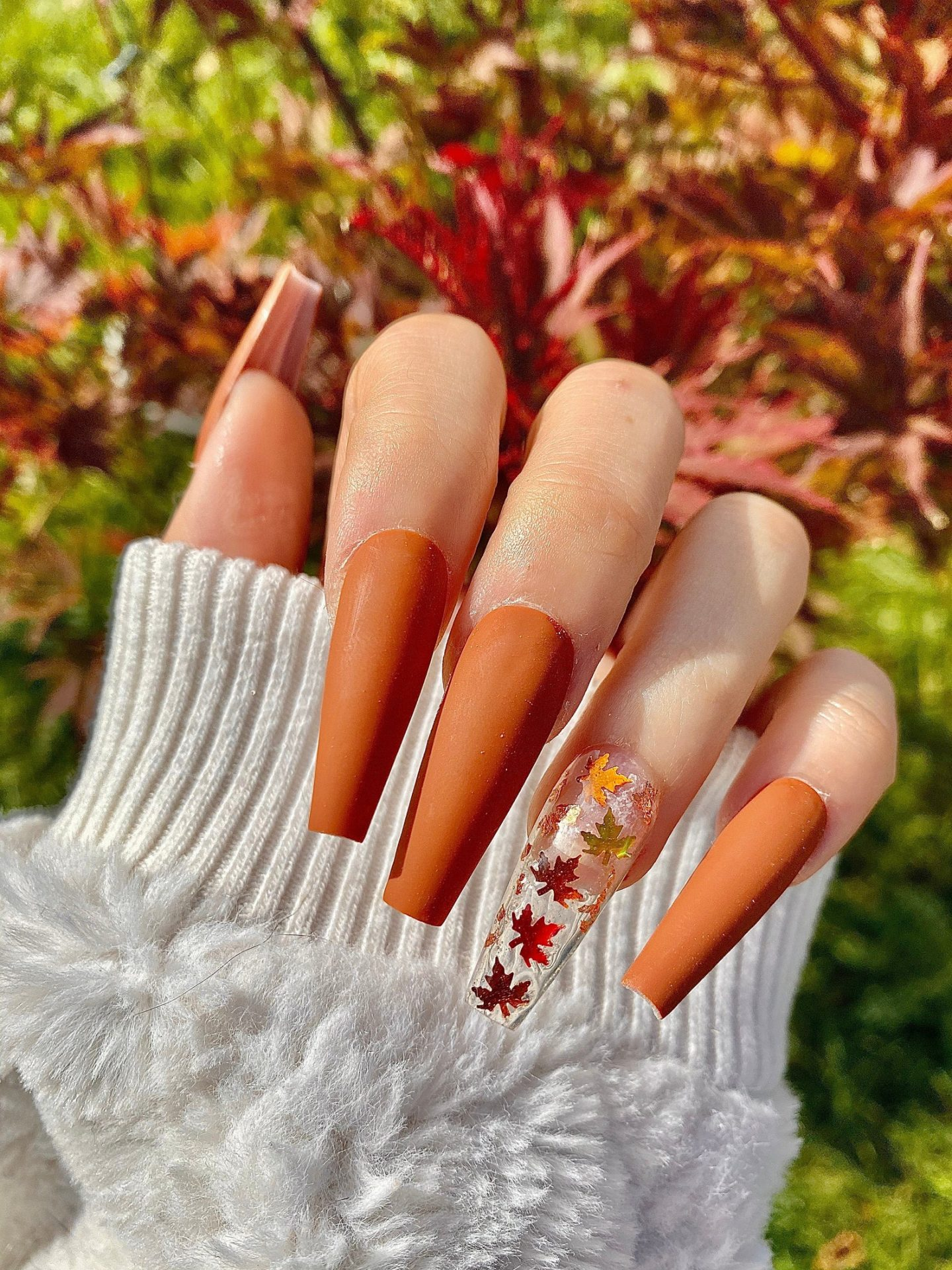 Burnt Orange Thanksgiving nails with maple leaves