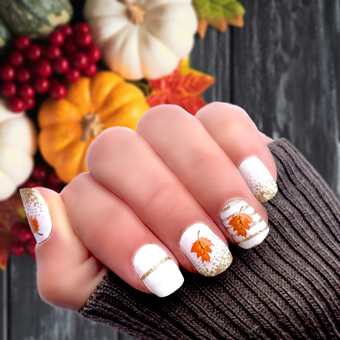 Short white Thanksgiving nails with maple leaf and gold foil