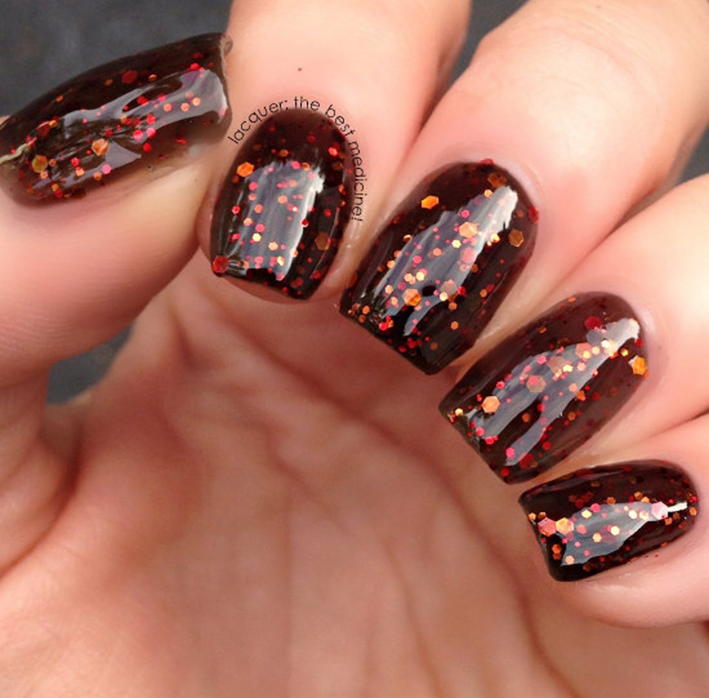 Cute short brown Thanksgiving nails with glitter