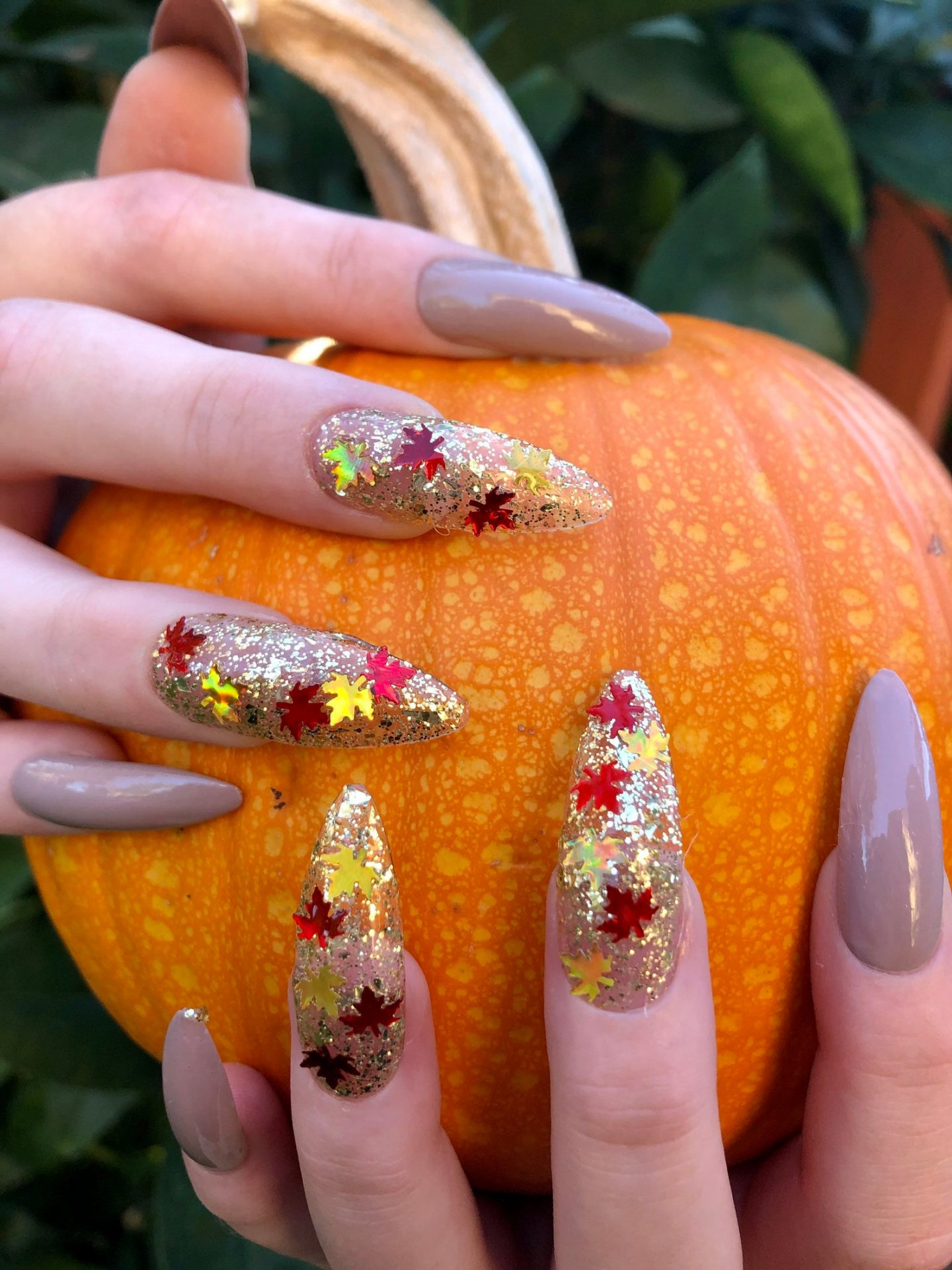 Taupe Thanksgiving nails with glitter and maple leaves