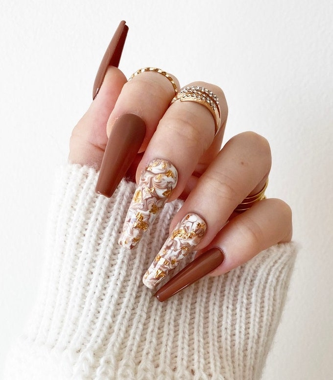 Long brown coffin nails with marble nail art